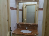 Obkládání koupelen ve školícím středisku na Bahenci